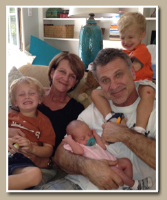 Dr. Hobar with his wife and grandchildren
