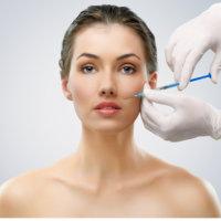 Pretty woman getting botox injection